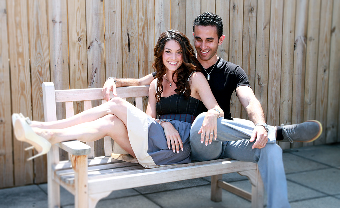 couple sitting together on bench