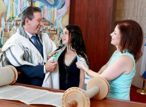 Mom Dad wrap Talia with her Tallis Temple Adath Shalom Morris Plains NJ