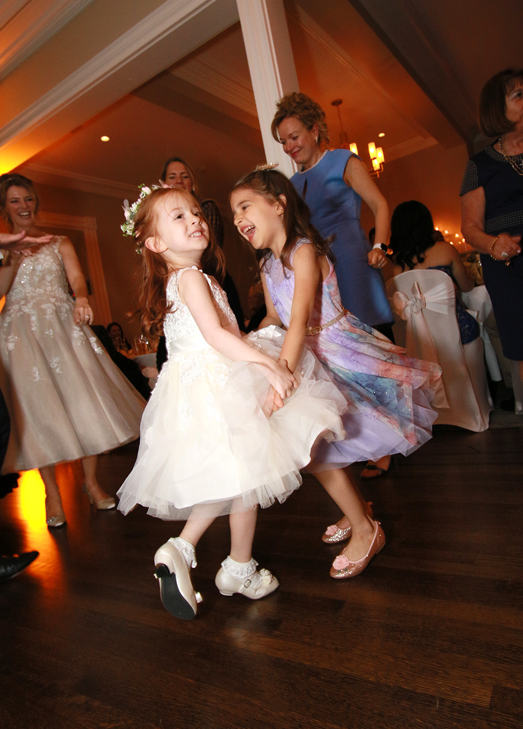 little girls dancing at wedding